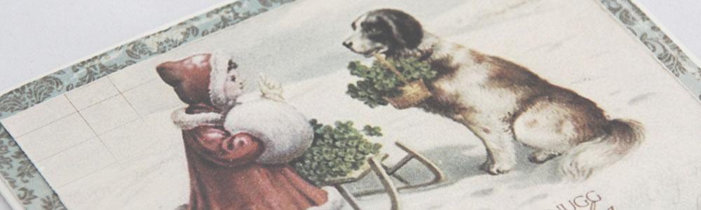 julekort med jente og hund front skrått PS